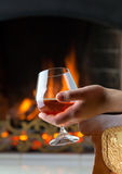 Resting at the burning fireplace Royalty Free Stock Photos