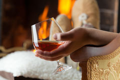 Resting at the burning fireplace Stock Photography