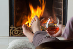 Resting at the burning fireplace Royalty Free Stock Photo