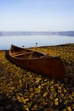 Resting canoe at Lake Toya, Hokkaido, Japan. A canoe that was left by the lakeside at Lake Toya while the owner camp nearby Royalty Free Stock Photos