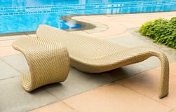 Resting chair by swimming pool Royalty Free Stock Photos