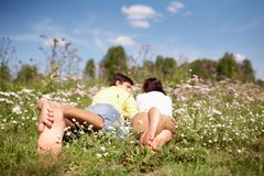 Resting couple. Image of couple resting with their legs in foreground stock photo
