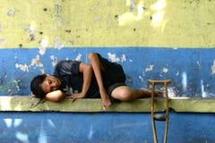 Resting Crippled Beggar Stock Image