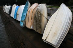 Resting dinghys against a rail Royalty Free Stock Image