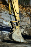Resting Excavator Bucket. This a close-up of an excavator bucket during construction of a road Stock Image