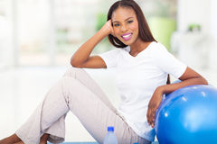 Resting after exercise. Pretty african woman resting after the exercise Stock Photo