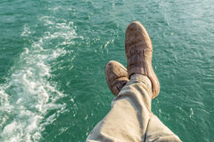 Resting feet over water surface Royalty Free Stock Images