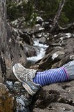 Resting feet by wilderness stream Stock Photo