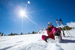Resting female skier in winter resort Stock Images