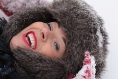 Resting and fun on the snow. Young smiling woman resting on the snow Stock Photo