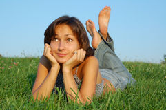 Resting girl. Girl resting on the green meadow stock photo
