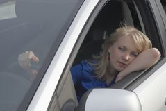 Resting girl after driving Stock Photos