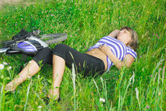 Resting in green grass Royalty Free Stock Image