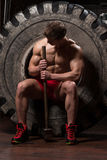 Resting After Hammer And Tractor Tire Exercise Stock Photo