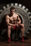 Resting After Hammer And Tractor Tire Exercise Royalty Free Stock Photography