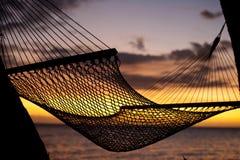 Resting hammock at sunset stock photography