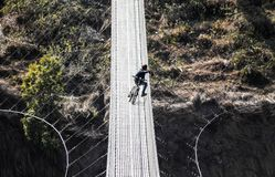 Resting in the height. One of the newest and longest suspension bridges in Pokhara. This spans across the Seti River royalty free stock images