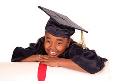 Resting on her diploma. Young girl resting on her diploma Royalty Free Stock Image