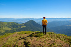 Resting hiker looking into the distance from the top of the moun Royalty Free Stock Image