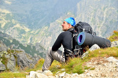Resting hiker on a mountain trail. Stock Photo