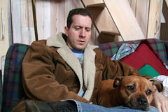 Resting on the House. Tired man with Dog stock photo