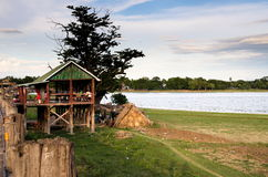 Resting hut at Taungthaman lakeside bank at U-bein bridge Stock Photos