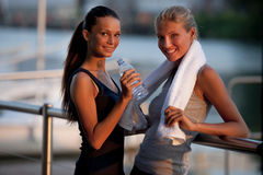 Resting after jogging. Young women resting after jogging Stock Images