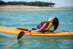 Resting Kayak Girl. A young tween girl takes a break while kayaking on Canyon Lake in the Texas Hill Country Stock Photography