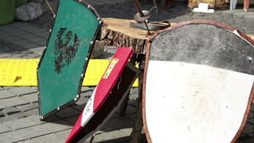 Resting Knights Shields. Various medieval shields with different coat of arms painted on stock video