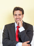 Resting latin businessman with suit and red tie Stock Photography