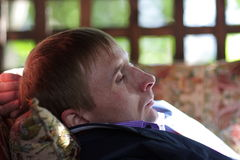 Resting man at summer house Stock Images