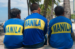 Resting manila city workers Royalty Free Stock Images