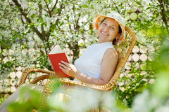 Resting mature woman Stock Images