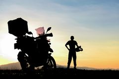 Resting Motorcyclist Near Mountains Stock Image