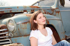 Resting on an old car Royalty Free Stock Photo