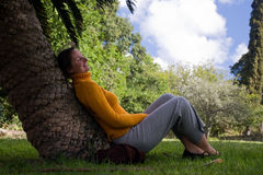 Resting in a park. Young woman is resting a a park in South African Republic Royalty Free Stock Photo