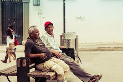 Resting people in white city popayan colombia south america. Resting men on the bench white city popayan colombia south america stock photo