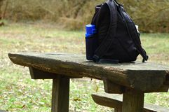 Resting place with a backpack. The field is the backround. stock image