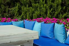 Resting place with blue pillows in the garden Stock Image