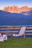 Resting place in Dolomites Alps of Italy. With focus on chair stock photos