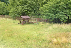 Resting place in the forest and fance. Fence and resting place in the forest stock photo
