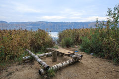 Resting place on the lake made of birch logs Royalty Free Stock Photos