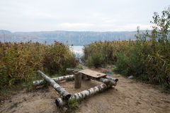 Resting place on the lake made of birch logs Royalty Free Stock Photography