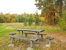 Wooden table and benches near road, Lithuania Royalty Free Stock Images