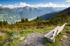A seat for resting in alpine mountains. Resting place at zillertal strasse in alpine mountains, Tirol, Austria royalty free stock image