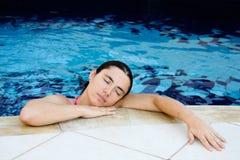 Resting at pool Royalty Free Stock Photo