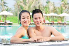 Resting in the pool. Close up portrait of a happy couple standing in the swimming pool Royalty Free Stock Image