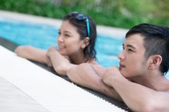 Resting in pool. Couple resting in the swimming pool Royalty Free Stock Photography