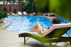 Resting by pool Stock Image