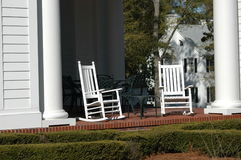 Resting on the portch. Scene on the porch of a large southern style building with the rocking chairs ready to relax in Royalty Free Stock Photo